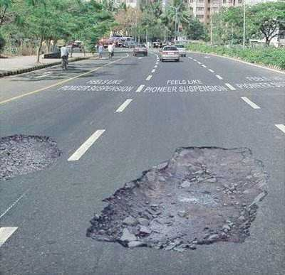 When drivers pass by, they almost stop completely due to the holes and to avoid car damages.