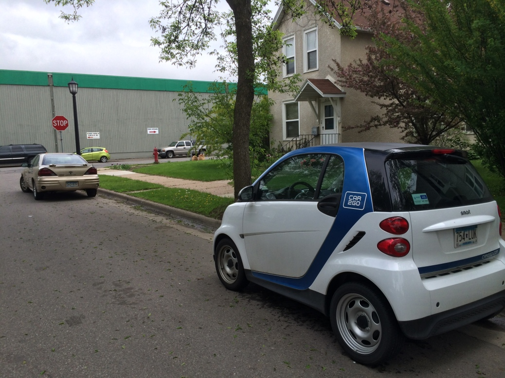 A car2go waits expectantly for its next user at the Minneapolis - St. Paul border (the car is in Minneapolis, the Weyerhaeuser warehouse at the end of the block is in St. Paul)