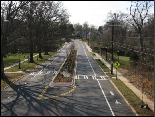 Charlotte Complete Streets-Rozzelles Ferry Road  Charlotte completely revamped Rozzelles Ferry Road. The streetscape was enhance by the addition of street trees and planting strips, while pedestrian crossing opportunities--as indicated by the crosswalk and corresponding refuge median--were added along the length of the road to make walking a breeze. The bike lanes facilitate cycling on road that previously unsuitable for riding. Photo: Charmeck.org (via Flickr, Creative Commons license)