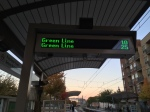 Transit Information Signs tell you when the Green Line is coming, unfortunately every 15 minutes. No need to check schedules though.