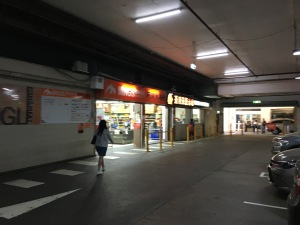 Ming's supermarket in the parking garage of Ashfield Mall. The future of parking structures is to be reclaimed for alternative uses.