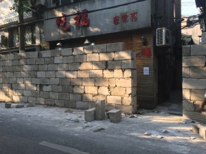 Along some streets, classical walls were being introduced or restored. I am not sure if the aim is aesthetics, sound proofing, or reducing business for annoying shops.