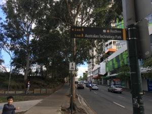Navigation sign to Redfern Station