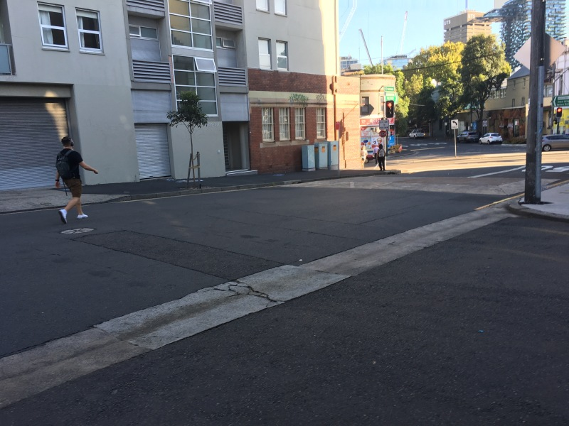 The intersection of Abercrombie Street and Cleveland Street in Darlington (Chippendale is across Cleveland) sees a speed hump on Abercrombie between Hudson Street (the lower right) and Cleveland (upper right). Pedestrians are continuously crossing in this stretch, but the speed hump aligns with neither unmarked crosswalk. Still, it's begging for pedestrians to use it, and they do.